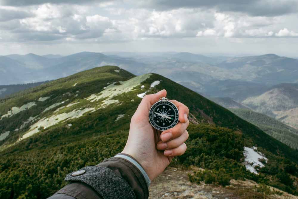 Man holding compass